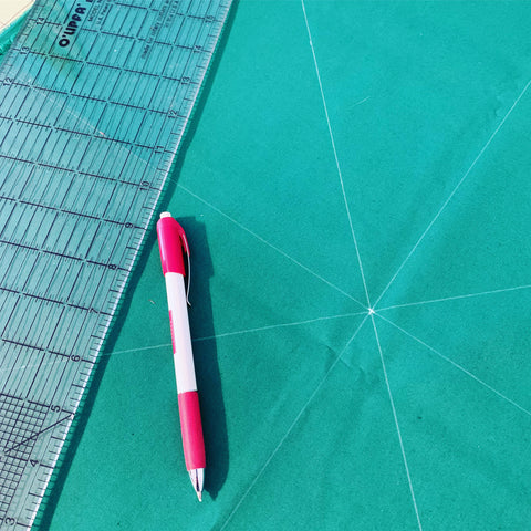 Making a circle on green fabric