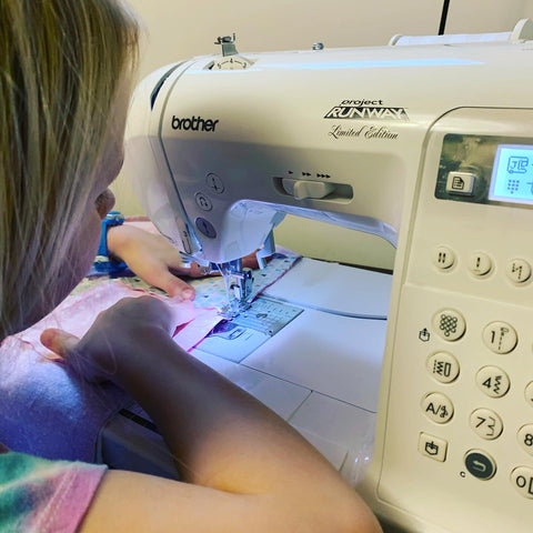 Daughter using the sewing machine