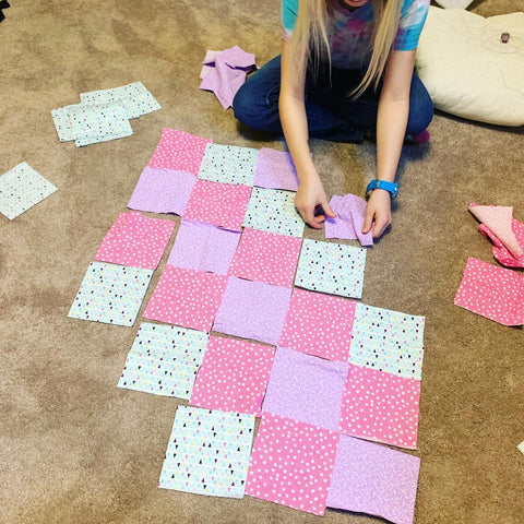 Laying out squares for a doll quilt