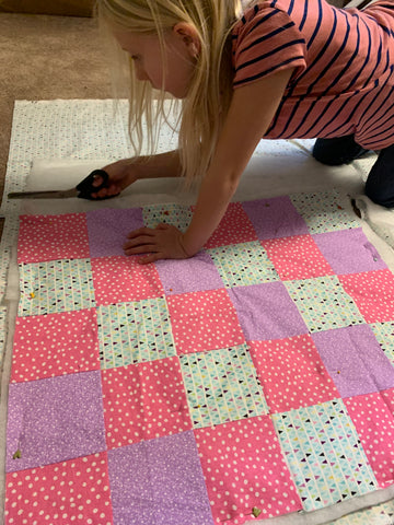 My daughter working on a quilt