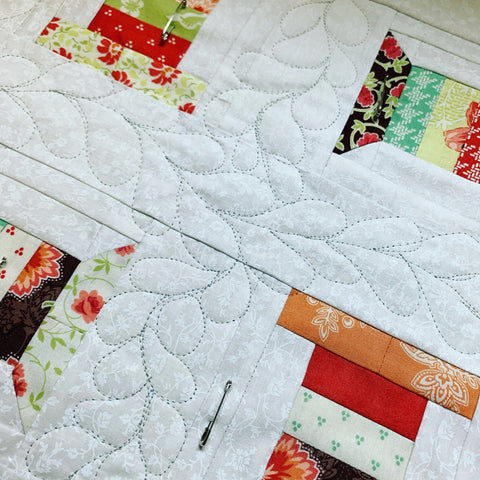 Machine Quilting feathers on the spool mini quilt