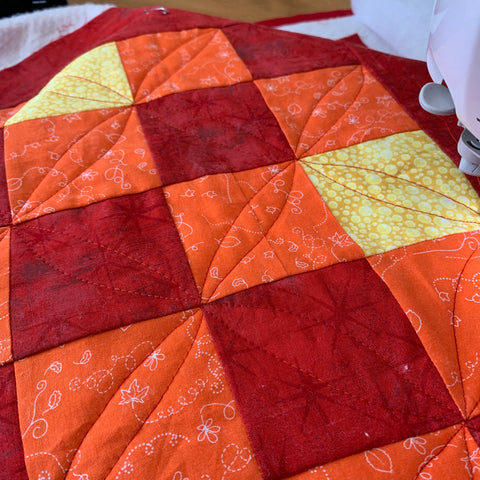 Quilting the red version of the Irish Woodland Quilt