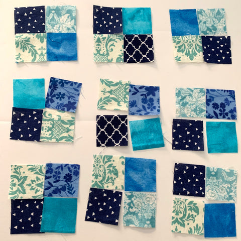 Mini Squares laid out for the four patches.
