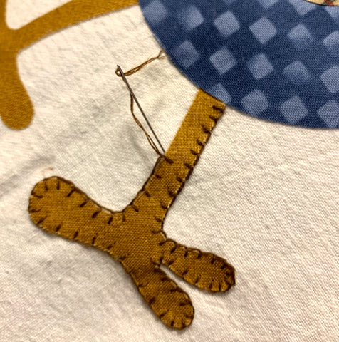 Ending the button hoe stitch on a chicken leg applique