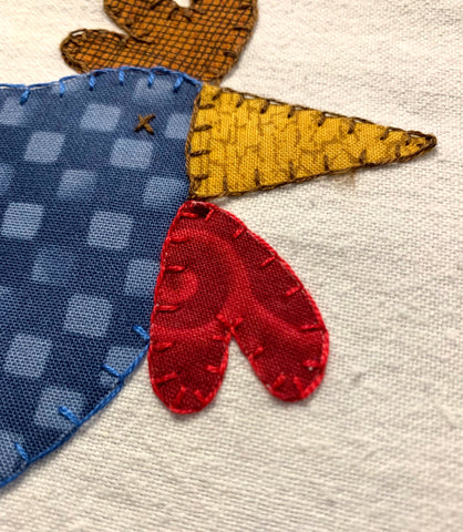 Finished head and beak of the chicken applique