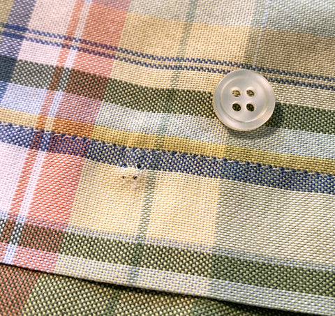 Seeing where the button needs to go on the shirt