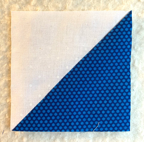 Finished half square triangles in blue and white