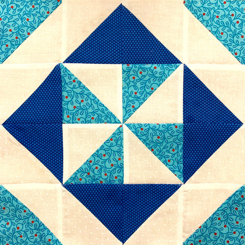 Pin Wheel Quilt Block in Navy Blue, Teal Blue, and White