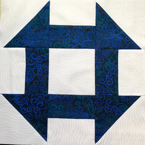 Churn Dash Quilt Block  - made with white and dark blue fabric prints