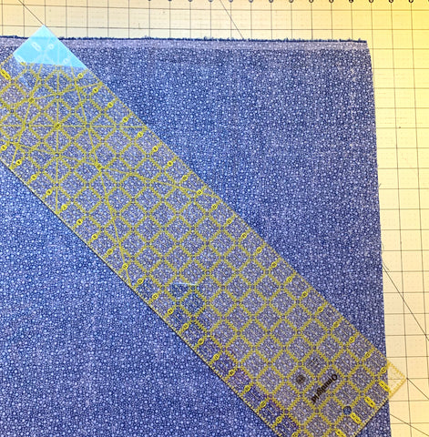 Ruler angled and fabric straight