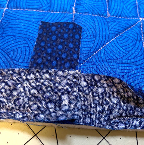 Joining the ends of binding. Cutting to the right length.