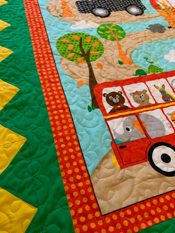 Close up of Fun Zoo and Vehicle Quilt Panel Baby Quilt