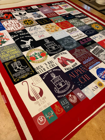 Tshirt quilt top laid out