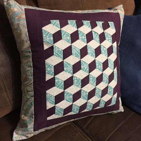 Finished Triple Woven Pillow in Teal, Purple, and Cream.