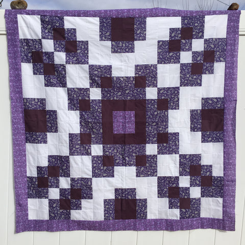 Violet Burst Quilt Pattern in purples.