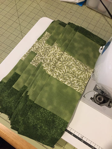 Strip piecing for the Irish Woodland Quilt laying on the sewing machine