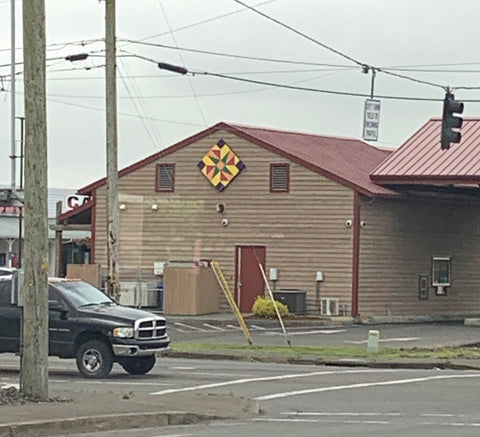 Barn Quilt on a brown building far away