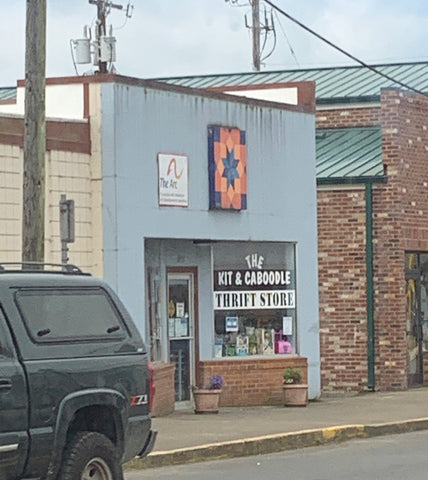 Barn quilt hanging outside a thrift store