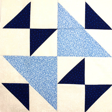 Triangle Weave Quilt Block in Dark blue and light blue with a white background