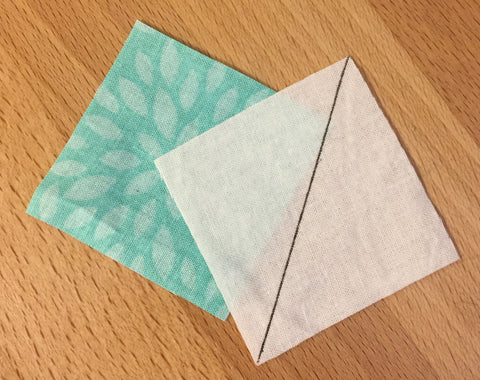 Two squares of fabric for Half square triangles