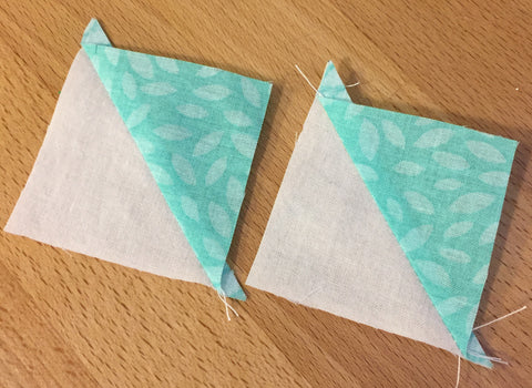 Half square triangle squares, ready to be trimmed.