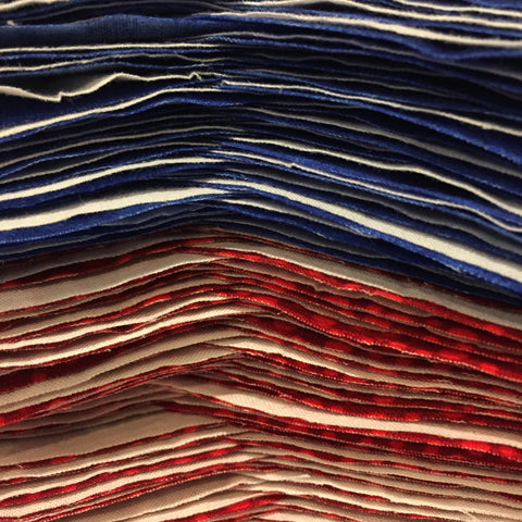 Blue, red and white fabric stacked
