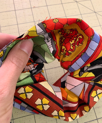 Matching the edges of the fabric together