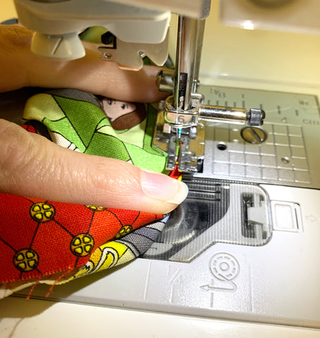 Stitching the edges of the fabric