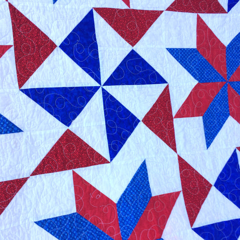 Close up of Bombs Bursting Quilt in Red White and Blue