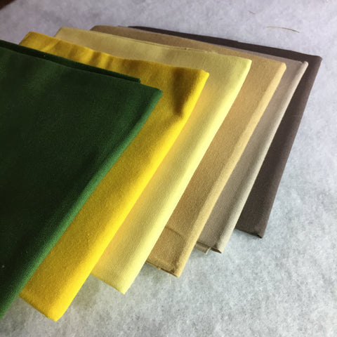 Fabric Selection of Browns, Yellows, and Green