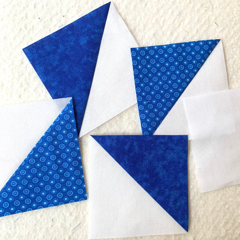 Half Square Triangles ready to be sewn together