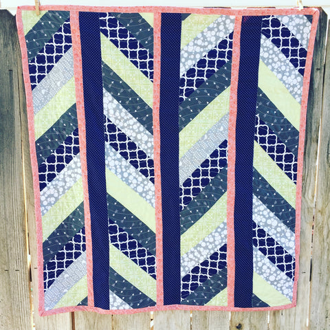 Navy, Grey, Lime, and Coral Baby Quilt with diagonal stripes
