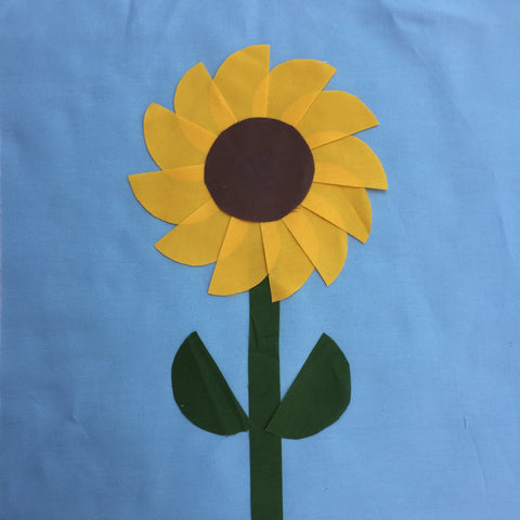 Sunflower laid out. Ready to be stitched in place.