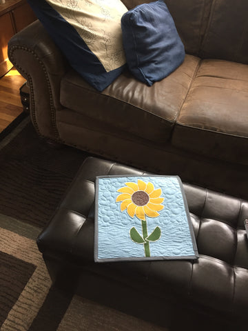 Sunflower Mini Quilt on a foot stool