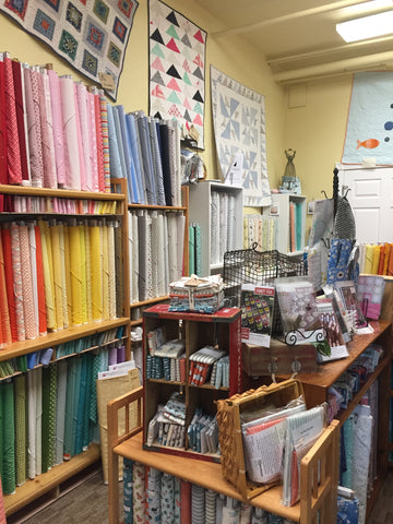 Inside the side room at Quilter's Attic. There is lots of cute fabrics