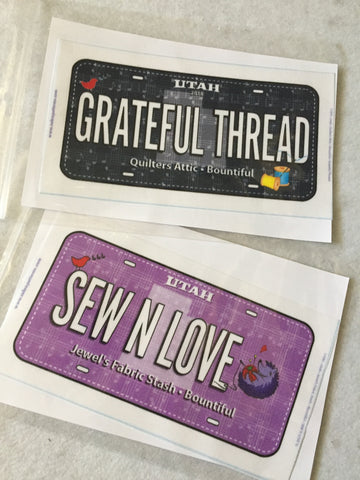License plates from Row By Row quilt shops in Bountiful, Utah.
