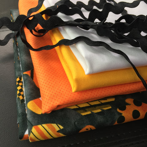 Fabric for Candy Corn table runner in White, Orange, Yellow, Black Print, and Black Ric Rac