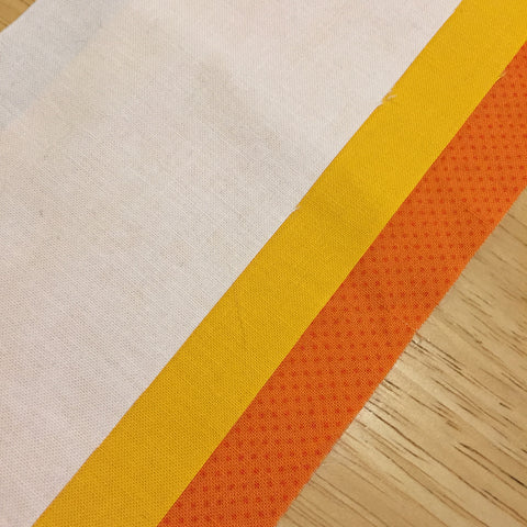 Strips of orange, yellow, and white fabric