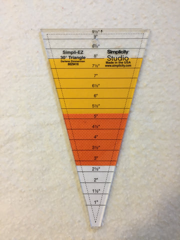 Trimmed candy corn fabric under the ruler.
