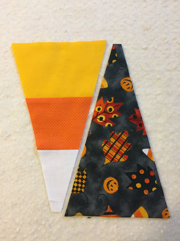 Alternating black with candy corn fabric