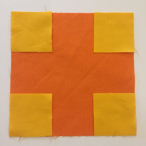 Yellow Squares in each of the corners of the orange square