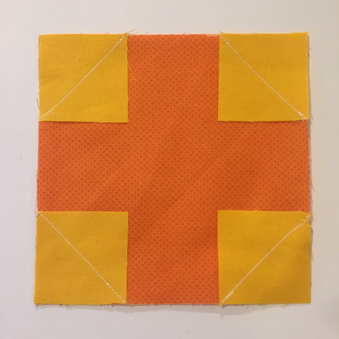 Yellow squares stitches to the orange square.