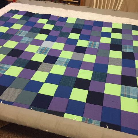Throw quilt on the quilting frame