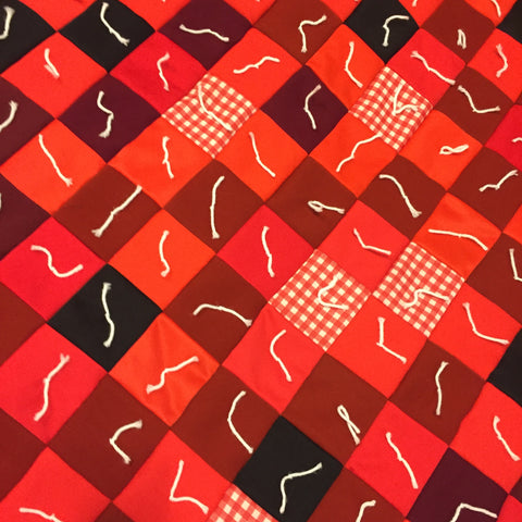 Throw quilt in reds, whites, and blacks