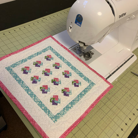 Card trick mini quilt on the sewing machine