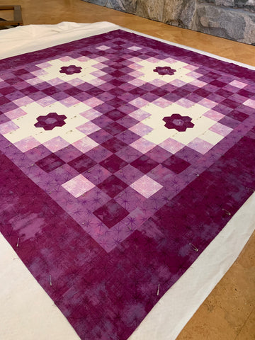 Pin Basting a Quilt - Look for missed spots