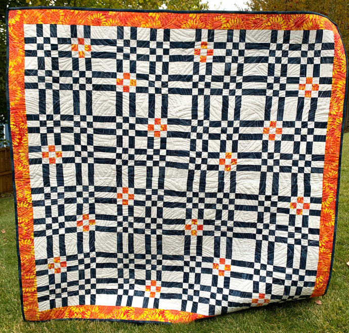 Color Seeds Quilt in Blue, Orange, and white. Like a plaid with lots of squares