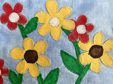 Close up of Sunflowers on a brick wall quilt row or quilt block