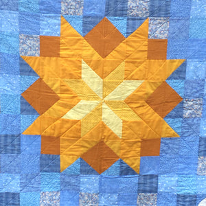 Close up of the sun center of the You Are My Sunshine Quilt.