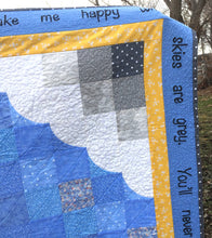 Close up the corner of the You Are My Sunshine quilt - looking at the clouds, borders, and wording.